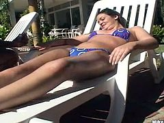 Take a nice look at this brunette, with a great ass wearing a bikini, while she gets banged hard after sucking this guy's shaft like a lollipop.