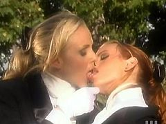 Julia Ann and Stormy Daniels take their equestrian clothing outdoors. They lick and finger each others wet pussies. Later on they start to drill their pussies with a dildo.