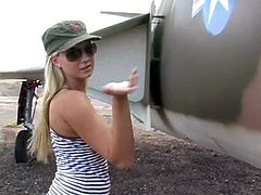 Delightful Alison Angel poses in a military uniform at a airfield near some plane. She shows her perfect tits and ass.