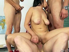 Three dudes team up to fuckin' bang this nasty-ass whore and give her the good old double penetration. Check it out right here!