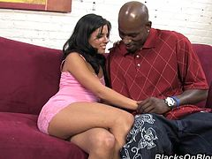 Check this brunette chick, with natural boobs wearing cute panties, while she has interracial sex and moans like a wild animal over a couch.