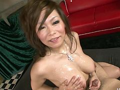 Busty brown haired Japanese kitty Ren gives double blowjob sucking two cocks. She gives nice blowjob and treats her boyfriends with oily titjobs.