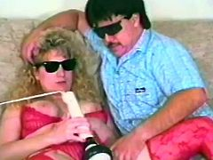 A kinky mature couple are petting each other in homemade sex clip. The mom rubs her cunt with a dildo and then kneels in front of her man to suck his dick.