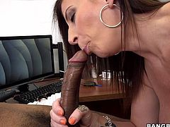 Instead of doing her work office manager Sara jay is wrapping her lips around a massive black cock. Her black boss is laying on the desk and she tugs him off really fast. She even goes so far as to give him a nice titjob. Look at how she moves her massive melons over top of his big black dong.