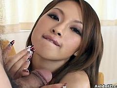 In her lingerie, Japanese Hikaru Houzuki is sexy and wanting his hard cock. She rubs her hands alog him and you can see clearly that she knows how to make him cum!