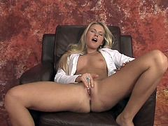 Blonde strips and masturbates