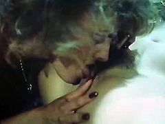 Dark haired small breasted lustful tramp lies on her back leg spread and her sultry sassy female helpmate gives her hairy snatch proper licking. Enjoy this saucy bitches in The Classic Porn sex clip!
