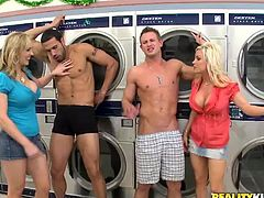 Two busty blonde cougars meet two handsome guys in the laundry. So, lustful women give passionate blowjob to the guys. There is one thing you have to know. These guys are naked while chicks in their clothes.