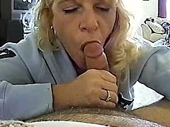 Amateur action will be making your mind blow, when this bitchy milf gets down on a huge cock and starts sucking it! She is a lust!