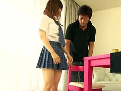 Cute Japanese girl looks sexy wearing college uniform. Horny guy feels up Miku's body. Then he pleases her pussy with vibrator.