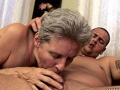 Kinky grannie in red fishnet gives yum-yum blowjob to one young dude