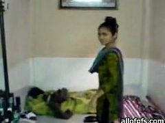 Passionate Indian teen couple fucks in a standing position
