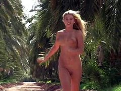 Click to watch this blonde babe, with giant boobs and a smooth cunt, while she touches herself and jump around in a solo model video.