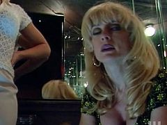Blonde milfs Nina Hartley and Serenity are having some fun indoors. They make out and caress each other and then favour each other with cunnilingus.