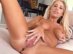 Her wet pussy being deep finger fucked makes Tasha Reign to moan of high pleasure