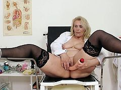 Mature nurse with a big toy up her pussy moaning of high pleasure