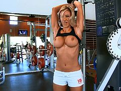 Sexy Anne has a workout in the gym. This sporty babe flashes boobs and also plays with her pussy. Anne also toys the pussy lying on a couch.