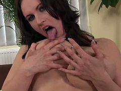 Olarita is an older slut with massive tits that can barely fit inside her bra. She puts her panties aside to stroke her clit and then she takes them off to put a dildo inside.