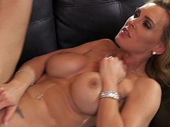 Press play to watch this blonde cougar, with big jugs wearing high heels, while she goes really hardcore with a lusty man over a black couch.