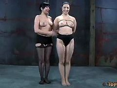 Madeleine Mei and Sister Dee wrestle half naked. The loser, Sister Dee must take all the punishment coming from Madeleine. She whips Sister Dee and sucks on her nipples.