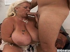 Kinky blonde fattie called Linda shows her huge boobs to some man and lets him rub his wang in between her natural jugs. Then she takes his boner into her mouth and sucks it hungrily.