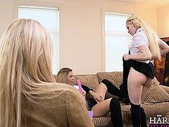 Hot girls share a dildo in front of female teacher