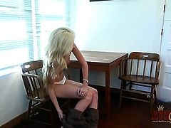 Blonde Emily Kae with tiny tities and smooth bush demonstrates her nice wet spot in solo scene