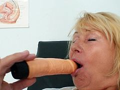 Amazing scene with blonde mature nurse pounding her cunt with a big toy