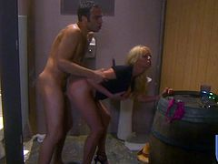 Hot blonde milf Stormy Daniels sucks and rubs her man's dick in a bathroom. Then they fuck in the reverse cowgirl position on the floor and enjoy it much.