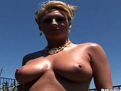 Have a blast watching this blonde cougar, with big gazongas wearing a bikini, while she toys her pussy and moans loudly covered in oil.