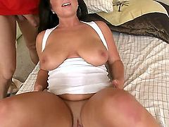 Dark haired chubby brunette Adella Skyy with big natural tits and french manicure fingers her shaved minge while sucking Preston Parker and rides on his cock in bedroom action.