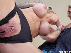 Gorgeous tattooed blonde Sarah Jessie in black panties bares her gigantic boobs before she gets her pink pierced pussy out. Busty Sarah Jessie sucks dick with legs apart before she takes it in her vagina.