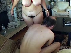 A housewife with huge boobs gives a blowjob to her hubby and then gets fucked in her pussy. Later on she also gets jizzed on her boobs.