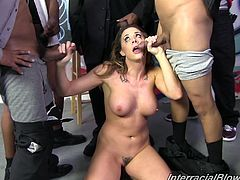 London Keyes strips down and sucks off several big black cocks before getting her face covered in cum in this interracial blowjob gangbang.