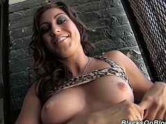 Just before her scene starts shooting, Rilynn Rae whips out her perky tits and flashes the camera as she does her pre-shoot interview.