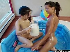This cute lesbian teen couple are really kinky. They love to get down and dirty. They douse theirselves in cream and milk and fuck their tight pussies with a dildo.
