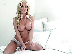 Angela Sommers has fire in her eyes as she plays with herself