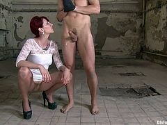 Mistress Madeline has her ways with blonde guys. She's a divine bitch with a superb body and a very dirt mind. This time she has Chris naked and with his hands tied in an abandoned warehouse and she's not gonna leave him unsatisfied. The whore taunts him and rubs his dick for a warm up. Curious what's next?