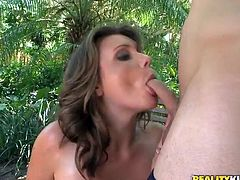 Press play to watch this brunette, with giant knockers wearing shorts, while she gets drilled hard after she serves a blowjob outdoors.