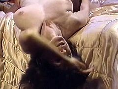 Curly brunette bombshell Kay Parker gives blowjob and gets plowed