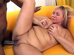 Take a look at this hardcore scene where a mature blonde is fucked silly by a guy's monster black cock as you hear her moan.