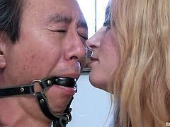 She's a blonde lady with an insatiable appetite for domination. This time Aiden brought in an Asian guy and she wants to make an example out of him. She tied the guy, ball gagged him and teased his dick. Aiden will ride him but she will not give him the pleasure too feel her warm, juicy pussy.