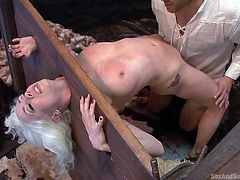 slim gorgeous chick in a victorian torture device