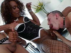Ebony whore Kayla plays with her body for us. She then calls her white twigs for more fun. The boys are crazy after her and begin to delight with her ass and cock. One passionately sucks her dick while she gives the other one head. Then, she stands up and receives a rimjob and head in the same time!