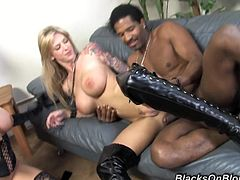 These two women take control of a black guy with a large dong by giving him a great blowjob and then taking turns fucking it like there is no tomorrow.
