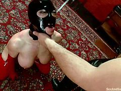With a metal hook in her ass and a latex mask on her head, Darling plays her role pretty good. We can say that this slut got hooked in the world of Sex and Submission. She absolutely loves to be obedient in front of a man and his hard cock so stay with her and enjoy her obedience.