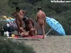 Naked mature couples at the beach