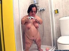 Fat, short and fucking horny Gidget acts really dirty in the shower! She washes her big saggy tits and her pussy making sure that she's squeaky clean. Let's stay with her and see what this bitch has to offer. Surely such a midget has a huge crave for our attention and cum!