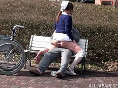 This nurse is a caretaker and the old age home and she sees that one of her patients needs to get some fresh air. She wheels him outside to the park on his wheelchair and then sits him down on the park bench. She sees he has an erection and then rides his old cock.