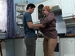 Granny was fingering her pussy in the kitchen, not knowing that there are so many guys looking for a hot grandma out there. Well, she found one this time and took out his cock immediately. Granny then sucked it hard and bent over to take some in her pussy too. The young dude pounded her ass an made her happy!